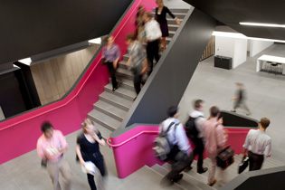 Photo of students walking down the main Rotman staircase