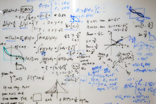 A photo of a whiteboard with writing