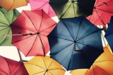 Abstract image of the underneath of umbrellas.