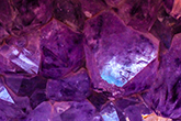 Abstract image closeup of uncut amethyst gems
