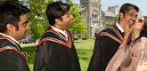 full-time MBA students celebrating graduation with their families on the lawn of King's Colleg Circle