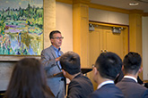 Image of the Dean speaking to MFRM students