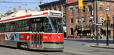 red street car on Spadina Ave